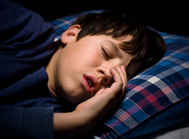 sleepingkid iStockphoto 137284541 630x463 Children Can Behave Better with Just 27 More Minutes of Sleep Per Night