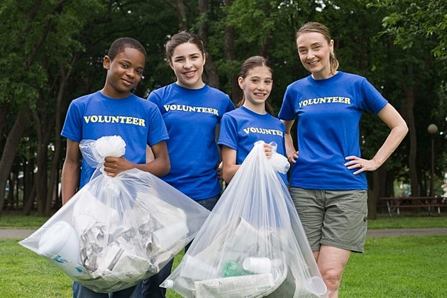 Volunteers holding trash bags