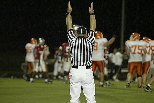 Referee at a Rain Football game