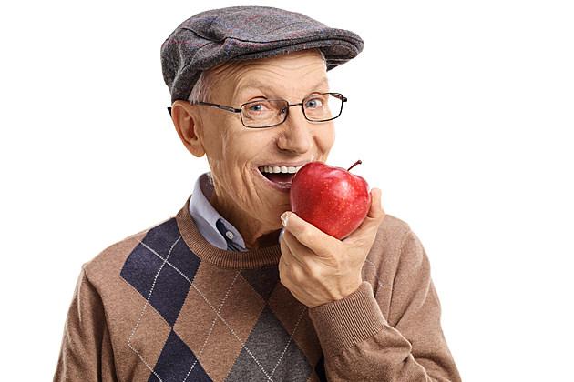 Senior having an apple